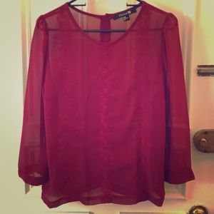 Red blouse with buttoned down back
